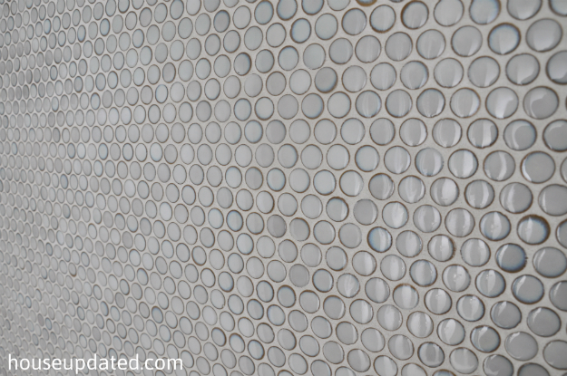 gray penny tile walls light grout