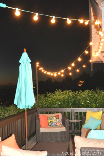 DIY outdoor string light posts for deck rails