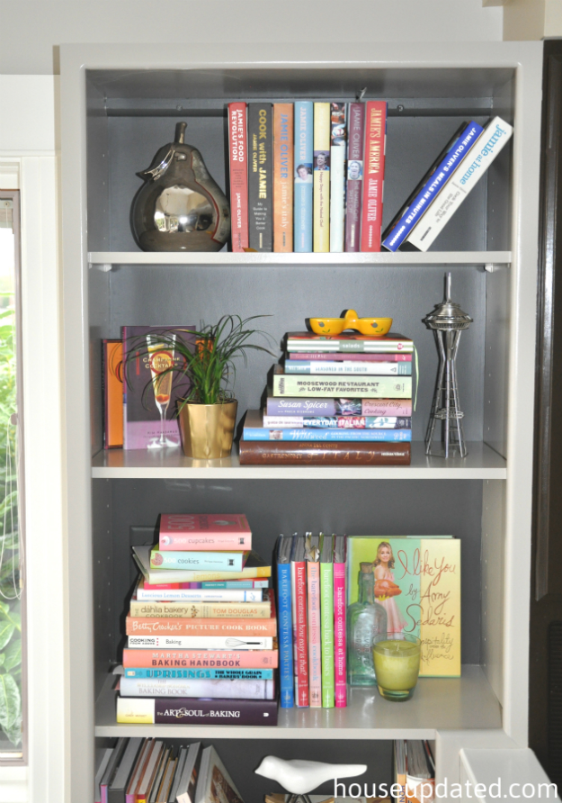 cookbooks on gray bookshelves