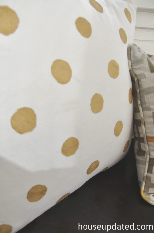 gold dot painted pillow