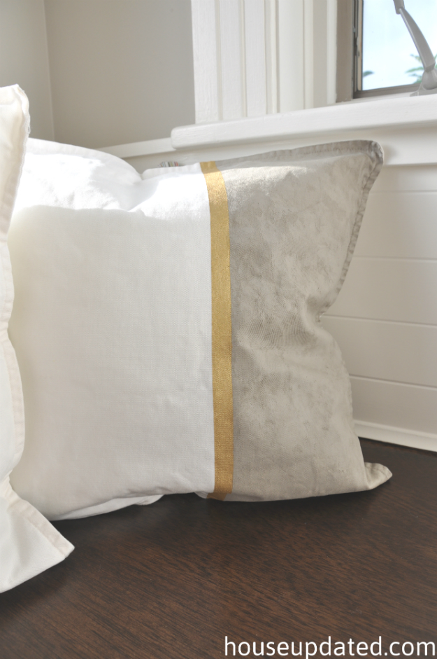 suede rockport gray and gold painted pillow