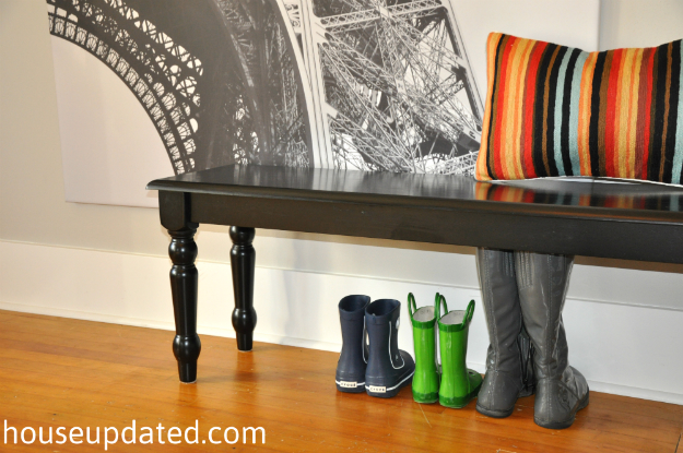 black entry bench with rainboots