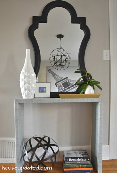 entry console table styling with curvy mirror