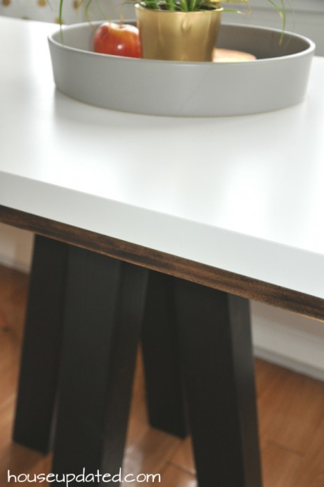 close-up on walnut trim for two-toned table