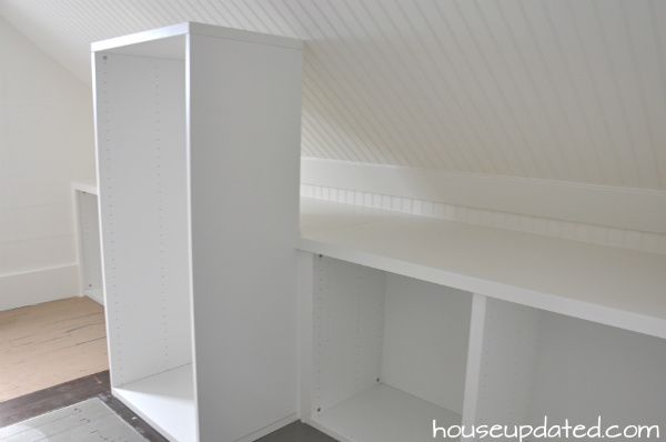 built-in ikea storage for sloped ceiling closet