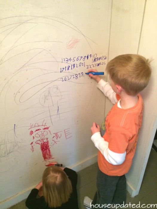 kids coloring on walls