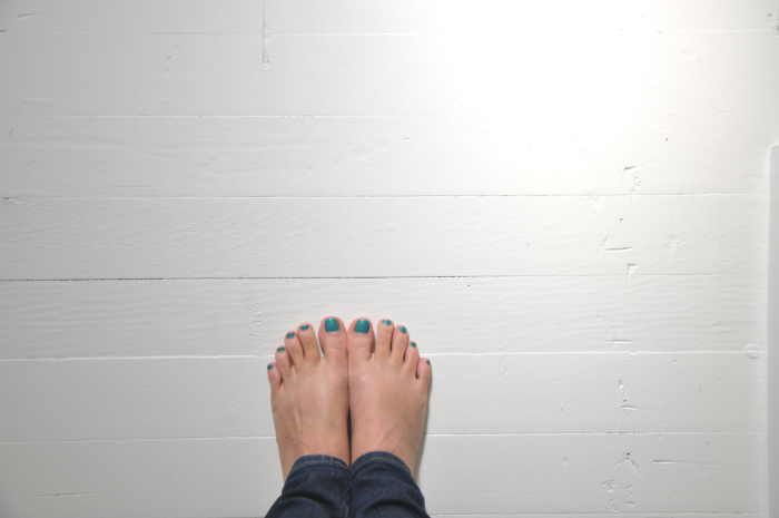 white painted floors with feet