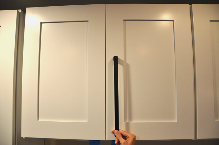matte black appliance pull on cabinet