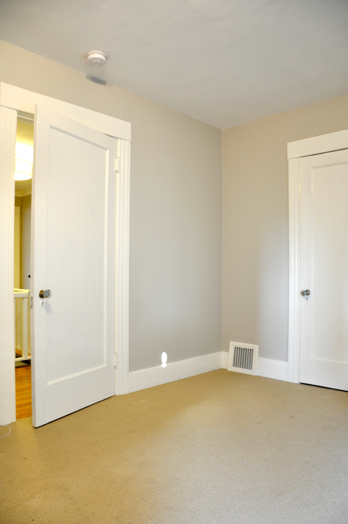 blank wall behind door