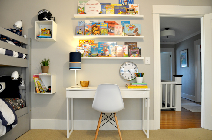 kid room desk books clock
