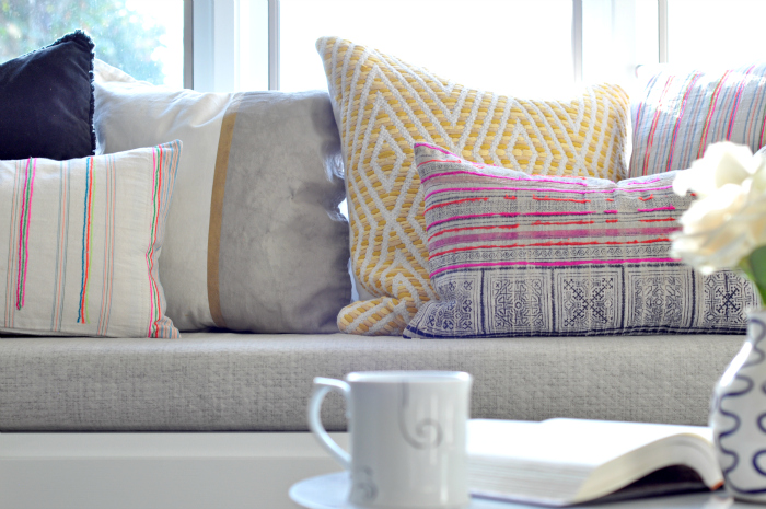 window seat pastel pillows