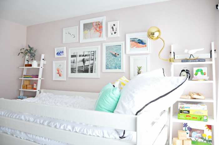 girl room gallery wall over bed