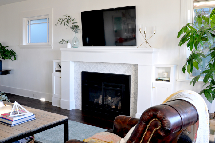 white fireplace living room leather chairs