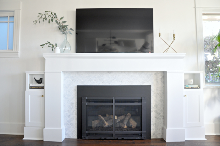 white marble tv over fireplace