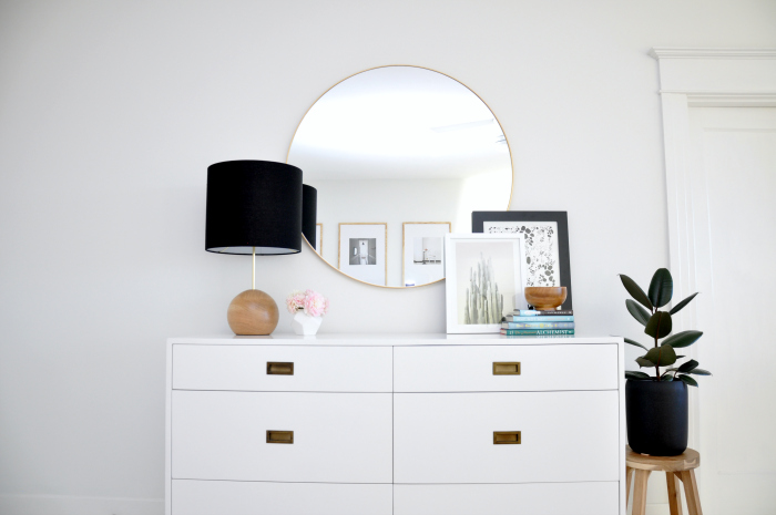 round-brass-mirror-white-dresser