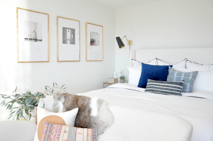 wood-frame-gallery-wall-white-bedroom