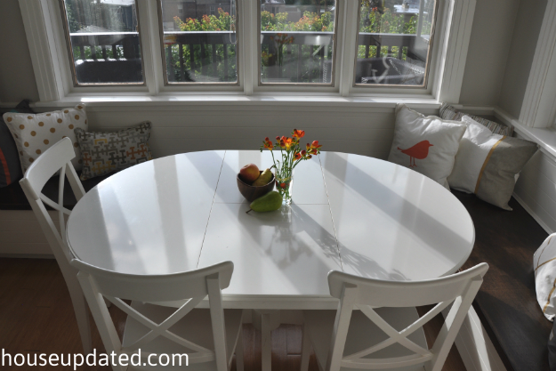 white oval kitchen table banquette paint pillows area all done house 233