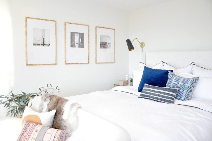 White Bed Blue Pillows Gallery Wall